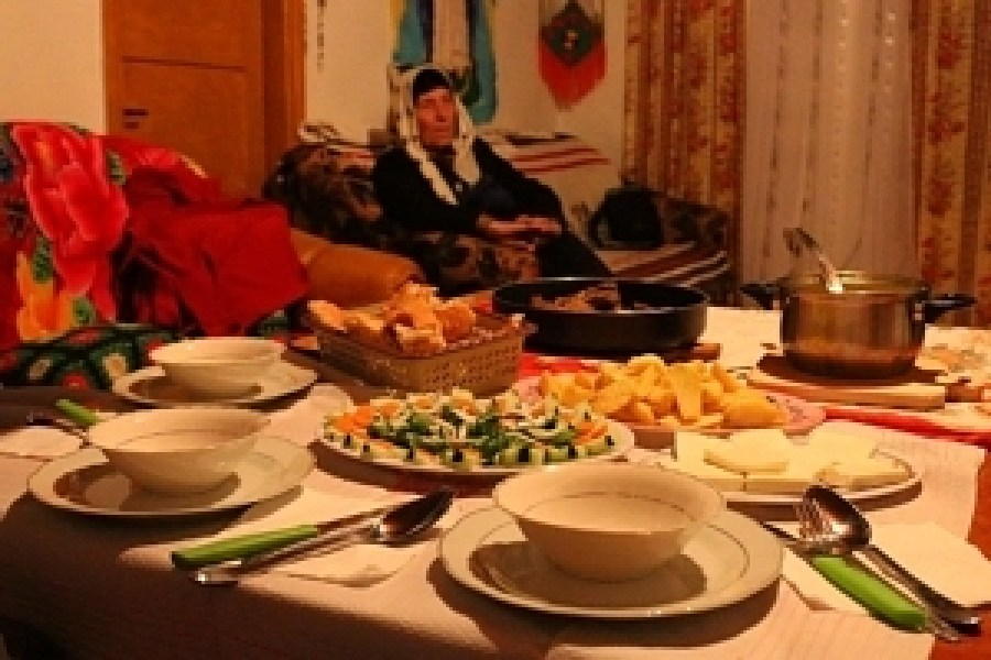 A feast of home-made goats cheese, beef stew, bread, chicken soup, chips, rakija and 'boronica' (a type of strong berry schnapps)