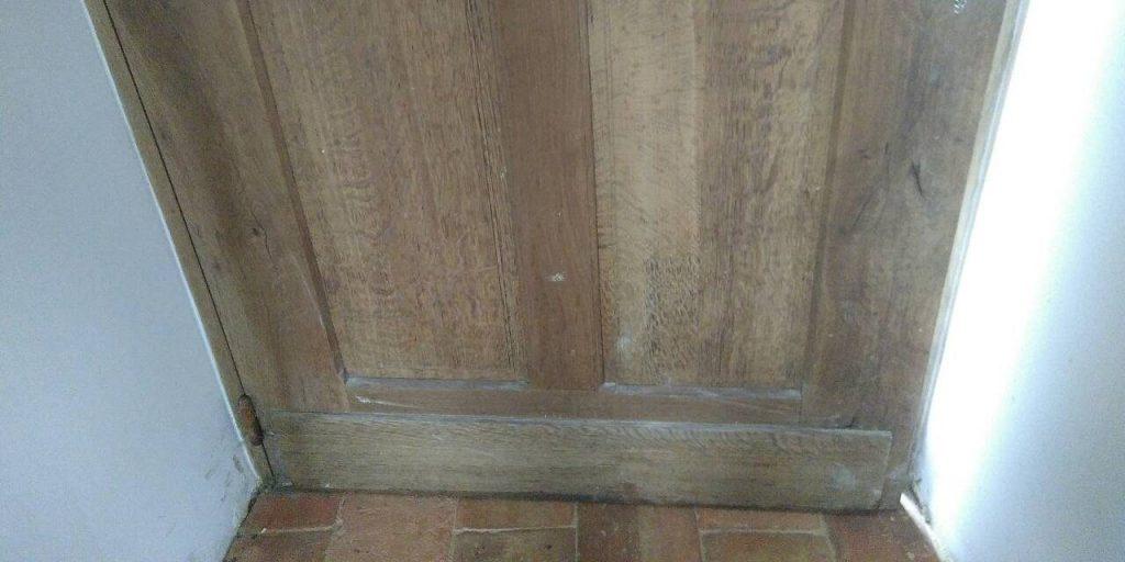 water damaged door