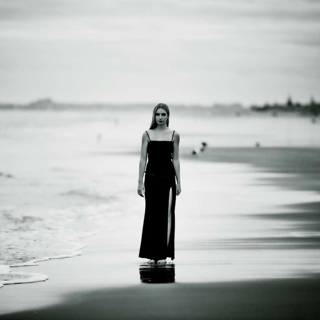 a woman in a black dress stands on the beach