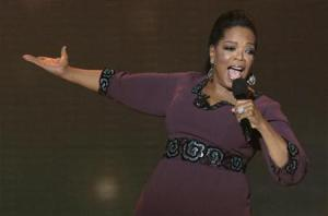 "Oprah Winfrey gestures during the taping of ""Oprah's Surprise Spectacular"" in Chicago"