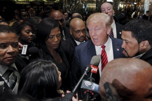 Presidential candidate Donald Trump speaks to the media after meeting with a group of black pastors at his office in the Manhattan borough of New York November 30, 2015. REUTERS/Lucas Jackson