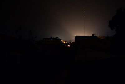 Landscape of a city or town at night that has been hit by an electricity power cut