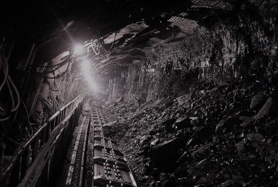 greyscale image inside a pit of a coal mine
