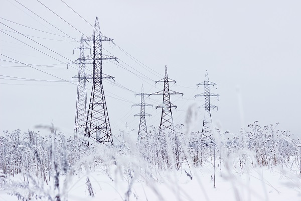 Electricity pylons on a winter's day with snow on the ground