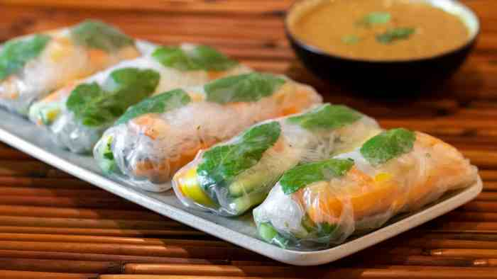 Cold Thai spring roll recipe with instructions for how to make with ripe paper, shrimp or chicken with vermicelli, Thai basil, carrots, cucumbers & mangos.