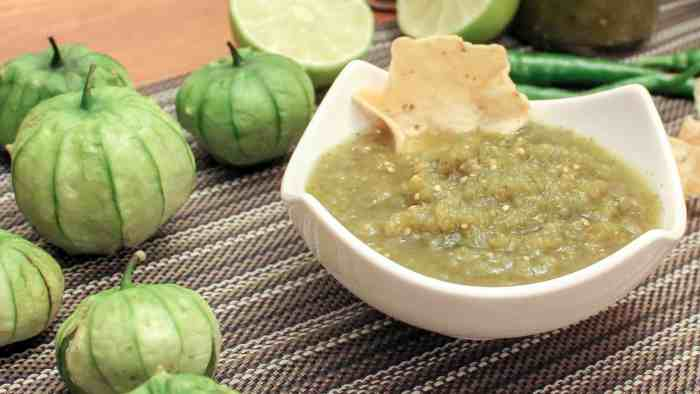 A spicy green salsa recipe made with tomatillos, cilantro, jalapeno or serrano peppers and lime juice. Great with nacho chips, enchiladas, taco, burritos and more!