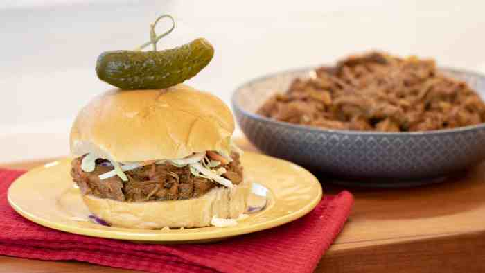 How to make pulled pork in a pressure cooker like an Instant Pot. Simple recipe that uses a pork roast, like a shoulder, blade or picnic, can of pop, BBQ sauce, onion, peppers, celery and mushrooms for a pulled pork full of flavour!