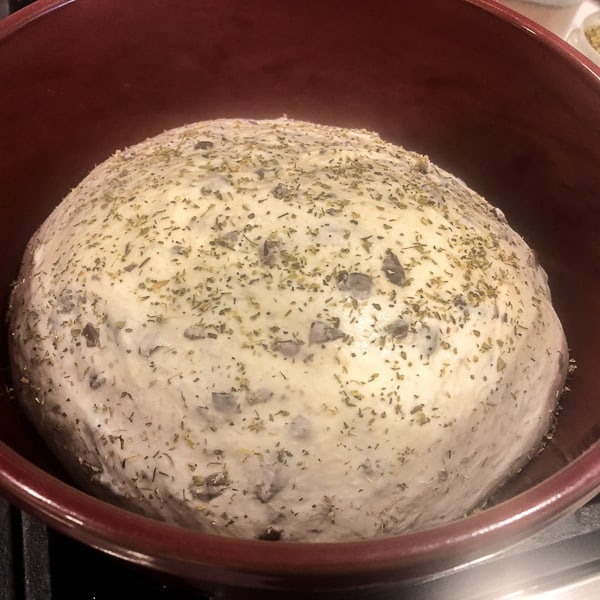 The dough should come away from the bowl and not be sticky/tacky to the touch.