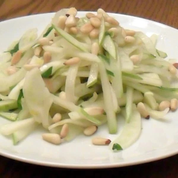 A fresh salad made with fennel, pear and pine nut salad with an orange and honey vinaigrette dressing.