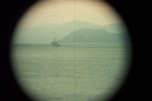 Mercuur seen through the periscope of  Dolfijn. Norway, between 5 and 7 Apr 2003. As most periscope shots this photo is taking with a standard digital camera which is held in front of the eye piece of the scope. (Photo: © Official Dolfijn website).