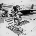 Tuskeegee Airman Reloads a P-51