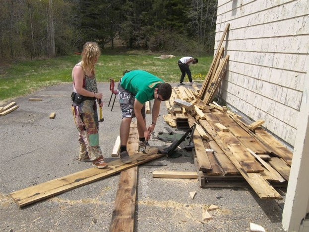 Pulling nails from used lumber