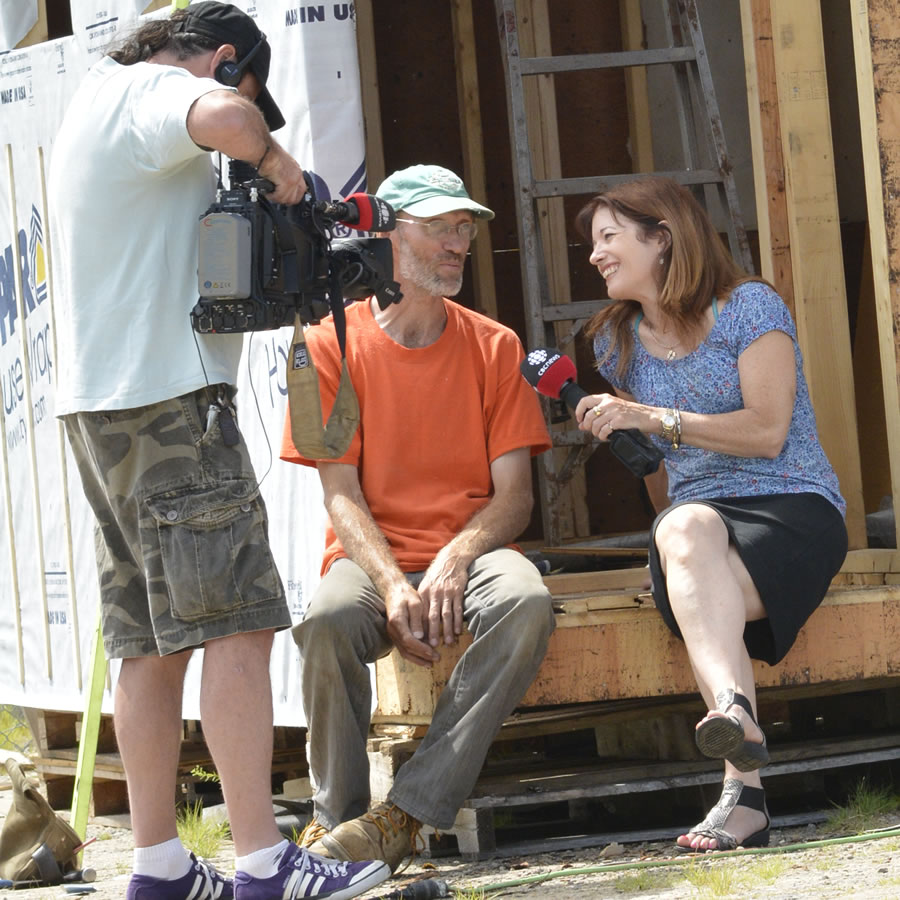 Lloyd Klassen being interviewed by Colleen Jones on the front porch of the Tiny Studio. D. Robinson photo