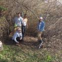 pic of 4 people on trail through bushes