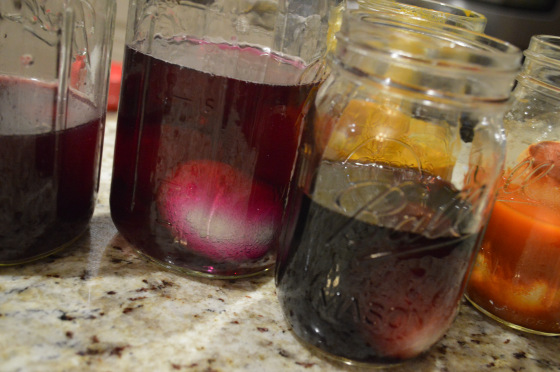 Mason jars worked great for holding the dye and eggs.