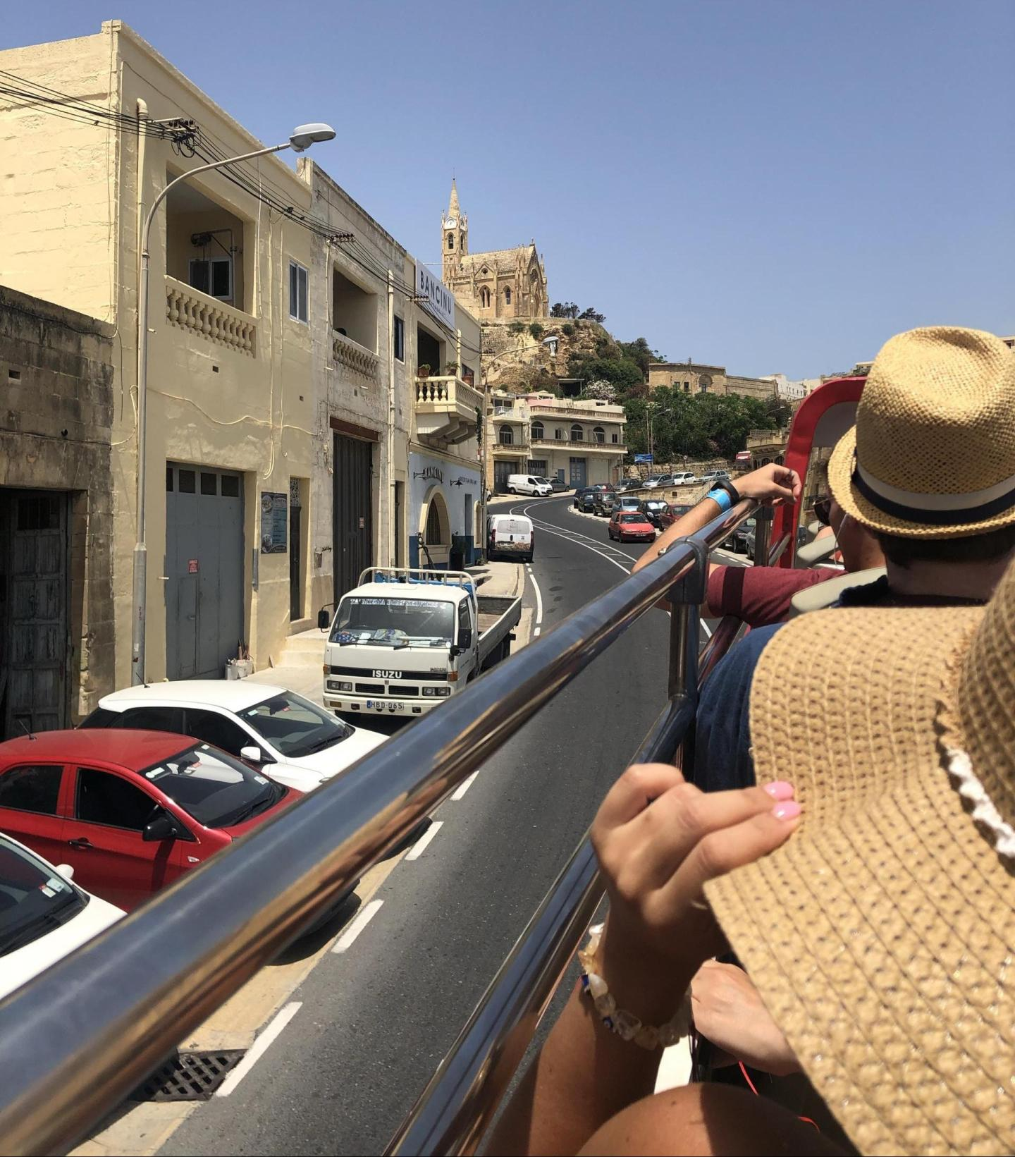 People on a tour bus driving through Gozo.