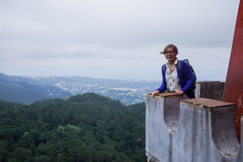 joanna stands on a viewing terrace in sintra on a windy day