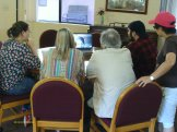 Melissa, Sylvie, Tee, Kevin, and Linda, chat with Cinzia Bottini on Skype from Singapore at a UPA doc Wrap Party.