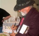 Larry Loc signing one of the souvenir programs.