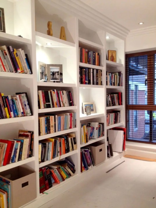 Contemporary shelving unit with recessed lighting for client in Barnes