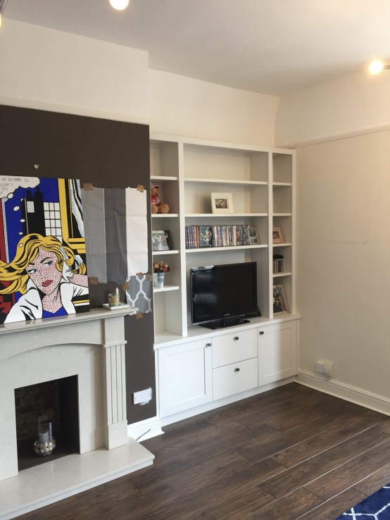 Purpose built bookcase with cupboards below