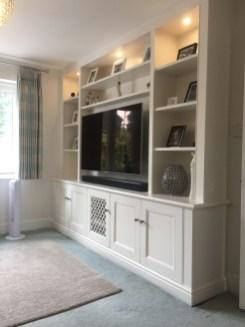 TV storage unit with cupboards below