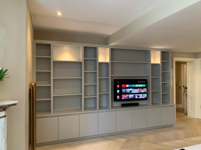 Wall to wall, floor to ceiling media bookcase
