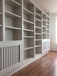 Bespoke shelving unit incorporating radiator cabinets