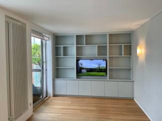 Wall to wall TV shelving