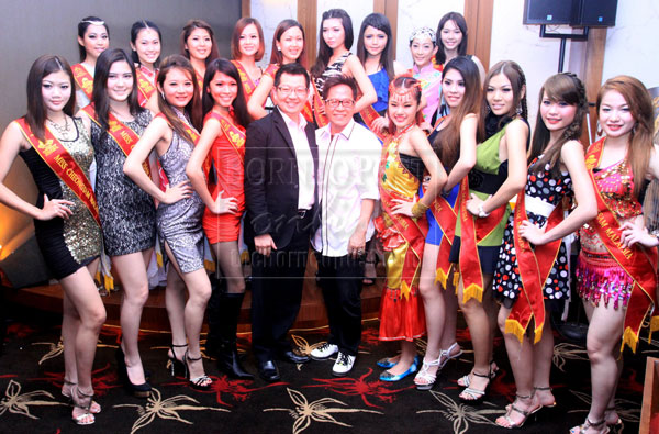 TALENTED LADIES: The girls are seen with Riverside Majestic Hotel manager Patrick Lau (front fifth left) and Alaric's Productions Company organiser and producer Alaric Soh after the show. — Photo by Jeffery Mostapa