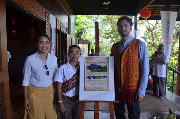 General manager of Aiman Planet Borneo Group of Companies Mona Abdul Manap (left), and Aiman Batang Ai Resort and Retreat guest relations and activities manager Ramona Ngalih with Brooke after the signing ceremony of the 'Fort Alice Escapade' brochure.