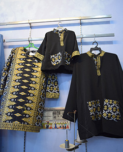 This set of Baju Kurung and Baju Melayu from Aleia Boutique in Miri incorporates the Kain Songket Borneo design on each piece.