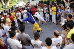Capoeira can be performed anywhere but usually in a roda (circle). The live percussion music and clapping from the capoeiristas serve to energise the exponents.