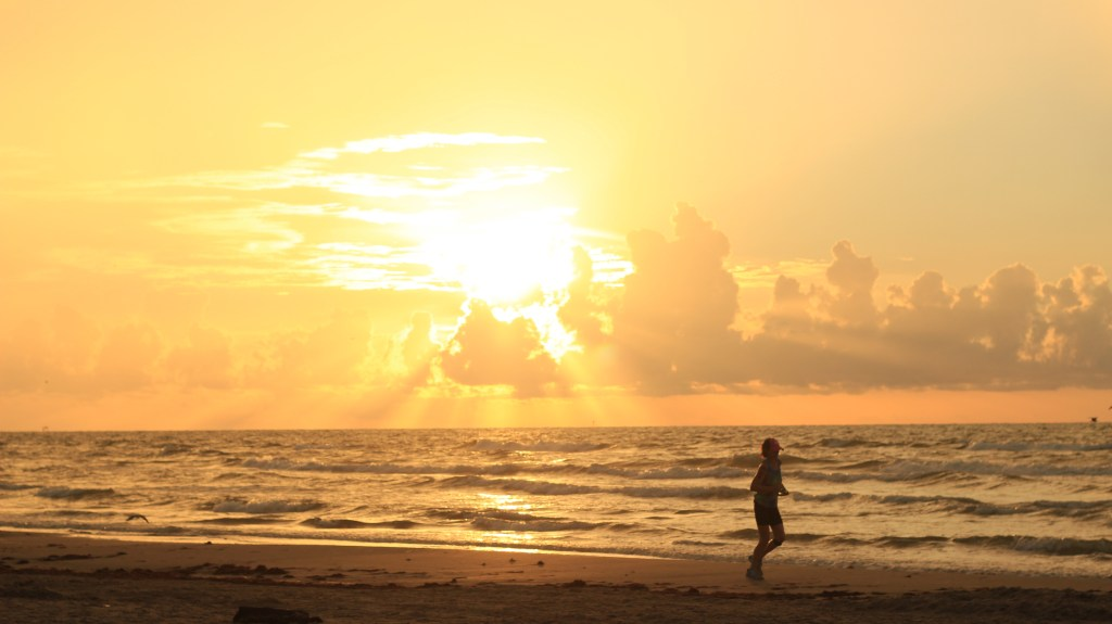 person running on beach, beach sunrise, sunrise run,