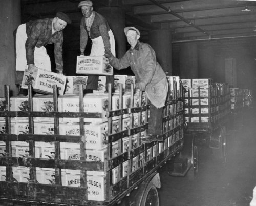 Anheuser-Busch St. Louis brewery workers load post-Prohibition Budweiser onto trucks for delivery.