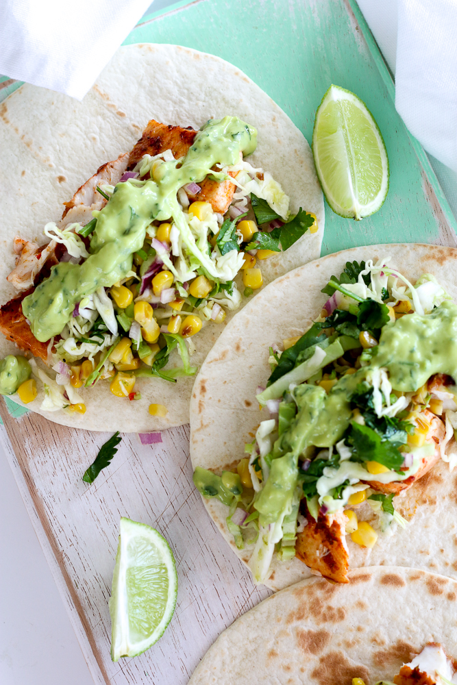 Spicy Fish Tacos with Grilled Corn Slaw and Avocado-Coriander-Lime Sauce - The Brick Kitchen