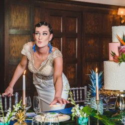 Beautiful 20s inspired bride sneaking a cookie