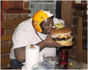 hungry fat man eating huge burger