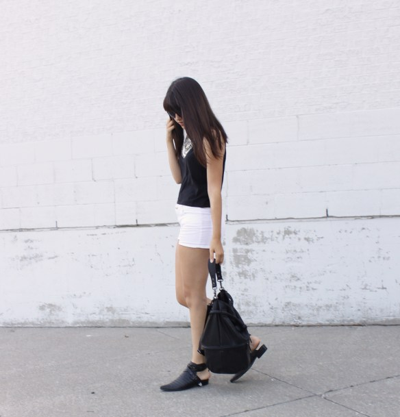 white-shorts-cutout-boots-bucket-bag