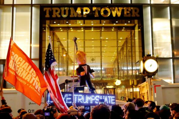 Protesters reach Trump Tower as they march against Republican president-elect Donald Trump in the neighborhood of Manhattan in New York