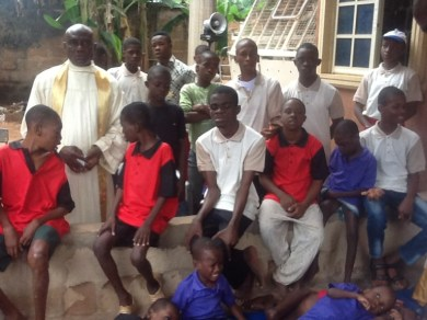 Rev. Fr. Ananwa (in cassock) now runs a home that provides education needs for handicapped children free of charge.
