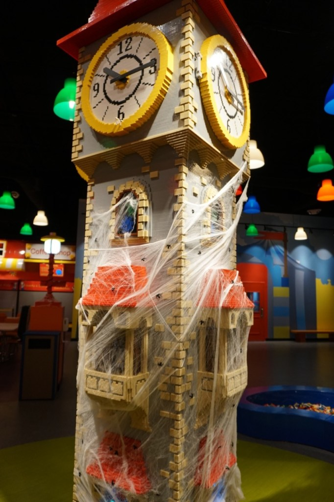 The clock tower is the center of the Discovery Center and it's decked out for Brick or Treat.