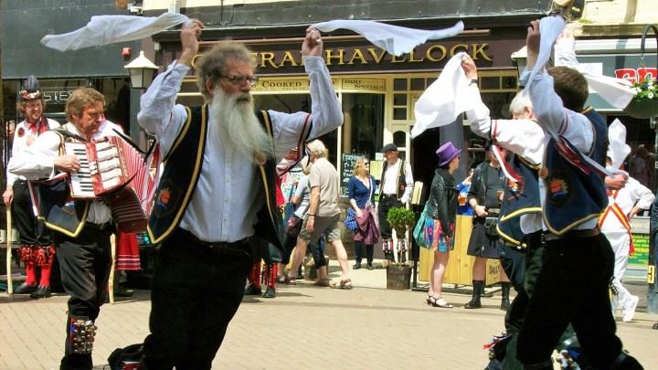 A group of morris dancers waving their hankies