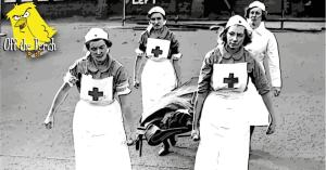 A woman on a stretcher being carried by nurses