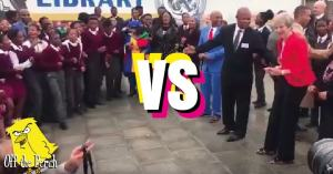 Theresa May facing some South African children with a 'VS' in between them