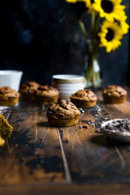 chocolate chip weed muffins sitting in front of some sunflowers.