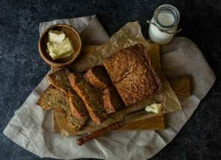 Butter beside banana bread