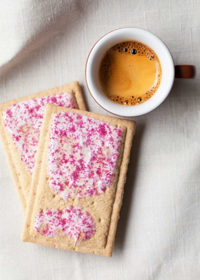 cannabis infused pop tarts on a tablecloth with a cup of coffee beside them
