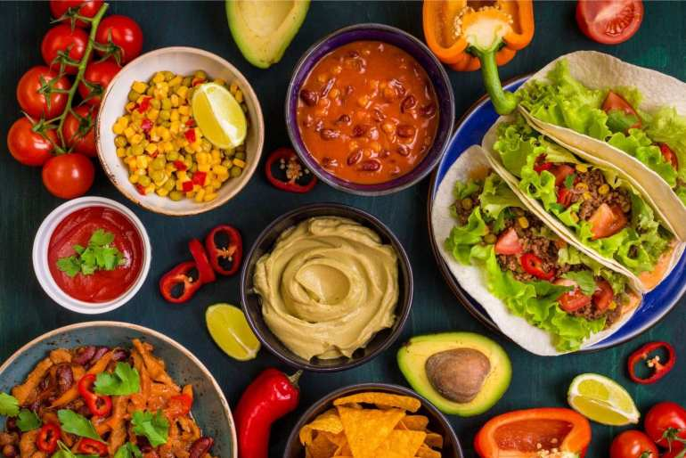 Overhead shot of all the ingredients used to make Mexican food including tacos