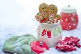 Cannabis infused gingerbread men in a jar with snow in the background